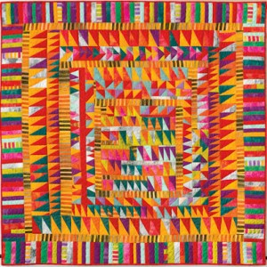 This is an image of a multi-colored quilt created by Gwen Marston and Freddy Moran.