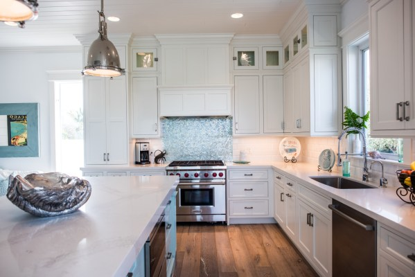 coastal kitchens with white cabinets White Coastal Kitchen Featuring Inset Cabinetry