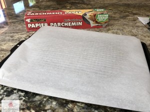 cookie sheet with cooling rack and parchment paper