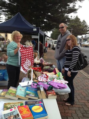 Krystal and Steven Prior from Greenwith in Adelaide checking out Lorraine Walters and Agnes Coutanche's great homemade gifts and food.