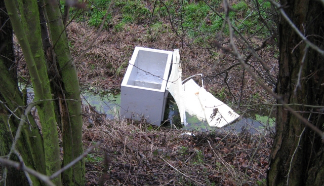 Fridge or freezer left in a ditch.