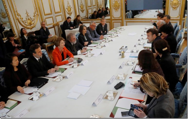 Scientists of the IPBES Hien Ngo, Eduardo Brondizio, Anne Larigauderie, Chair of the IPBES Robert Watson, Sandra Diaz, Josef Settele and Paul Leadley attend a meeting with French President Emmanuel Macron at the Elysee Palace in Paris, France, May 6, 2019. Michel Euler/Pool via REUTERS