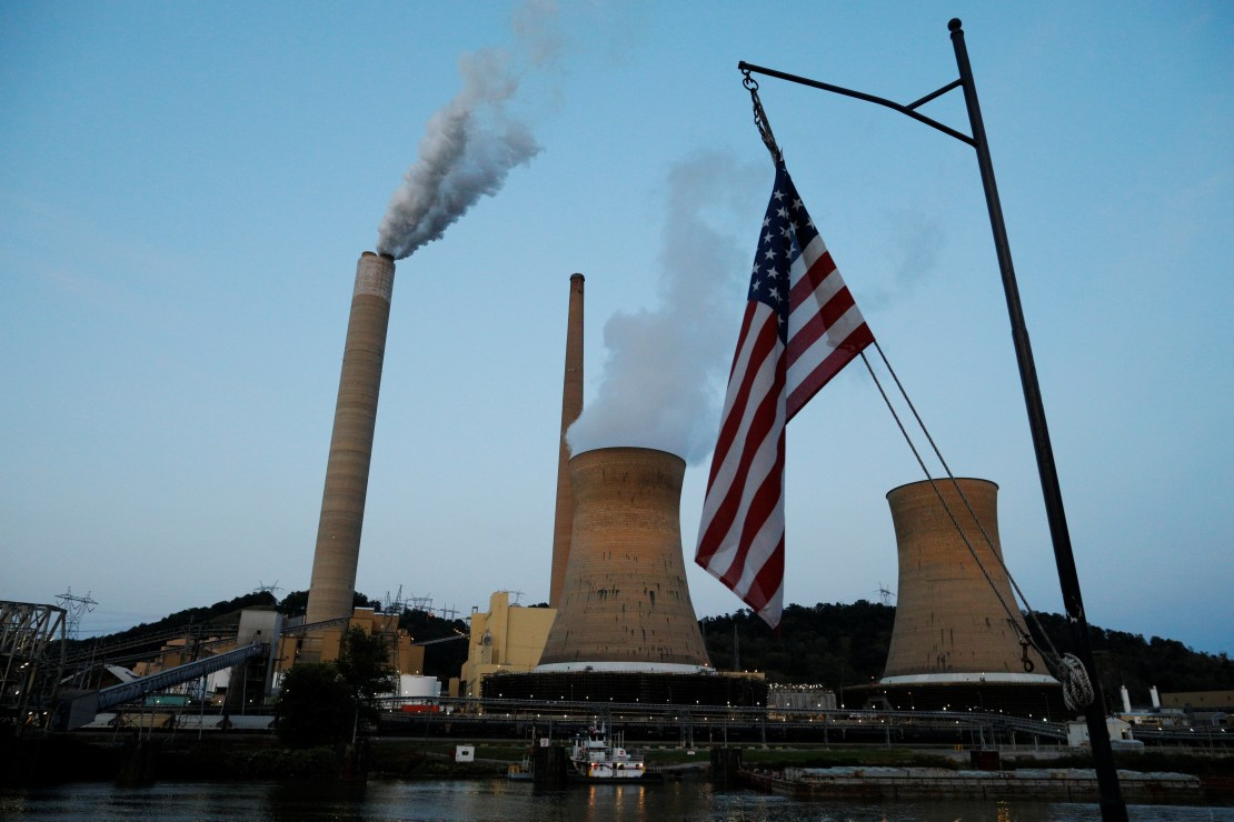 The U.S. flag flies on Campbell Transportation's towboat M.K. McNally as it passes Mitchell Power Plant, a coal-fired power-plant operated by American Electric Power (AEP), on the Ohio River in Moundsville, West Virginia, U.S., Sept. 10, 2017. REUTERS/Brian Snyder