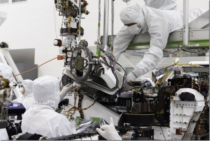 The bit carousel, which lies at the heart of Sample Caching System of NASA's Mars 2020 mission, is attached to the front end of the rover in the Spacecraft Assembly Facility's High Bay 1 at the Jet Propulsion Laboratory in Pasadena, California. The carousel contains all of the tools the coring drill uses to sample the Martian surface and is the gateway for the samples to move into the rover for assessment and processing. Credits: NASA
