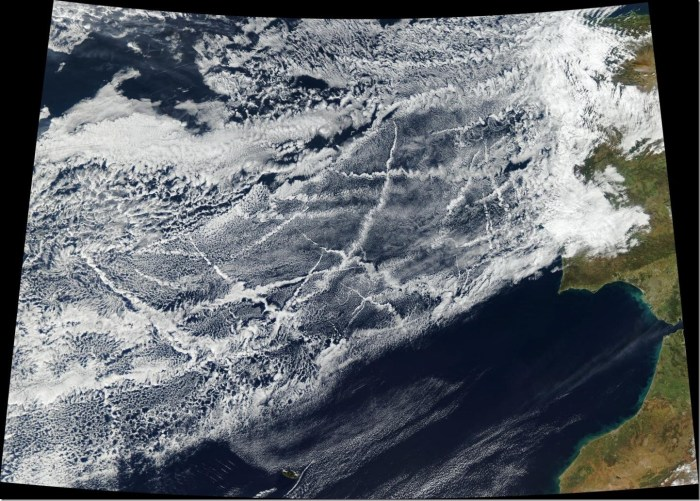 This satellite image was taken January 16, 2018, off the coast of Europe. Pollution from ships creates lines of clouds that can stretch hundreds of miles. The narrower ends of the clouds are youngest, while the broader, wavier ends are older. Credit NASA Earth Observatory