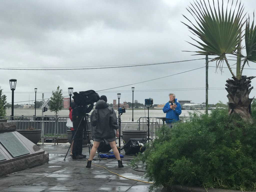 New Orleans before the storm has news reporters broadcasting from the French Quarter