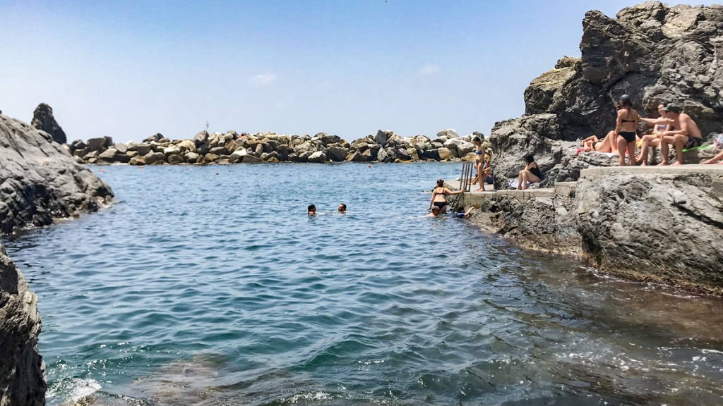 Visiting Cinque Terre means going for a swim in the clear waters