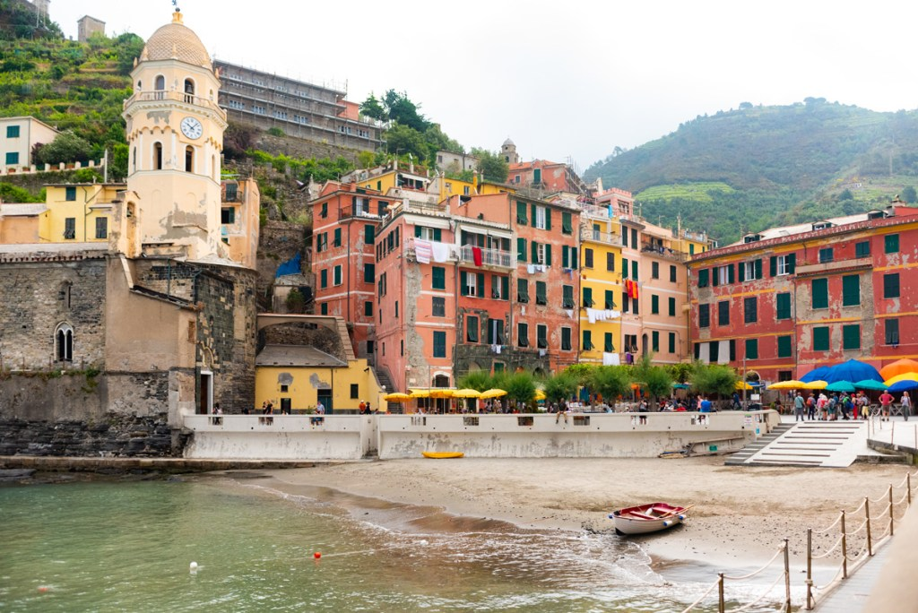 Visiting Cinque Terre Vernazza is colorful with a small beach