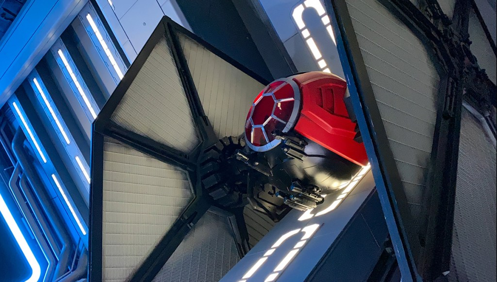 Star Wars Rise of the Resistance tie fighter dominates the scene in the hangar