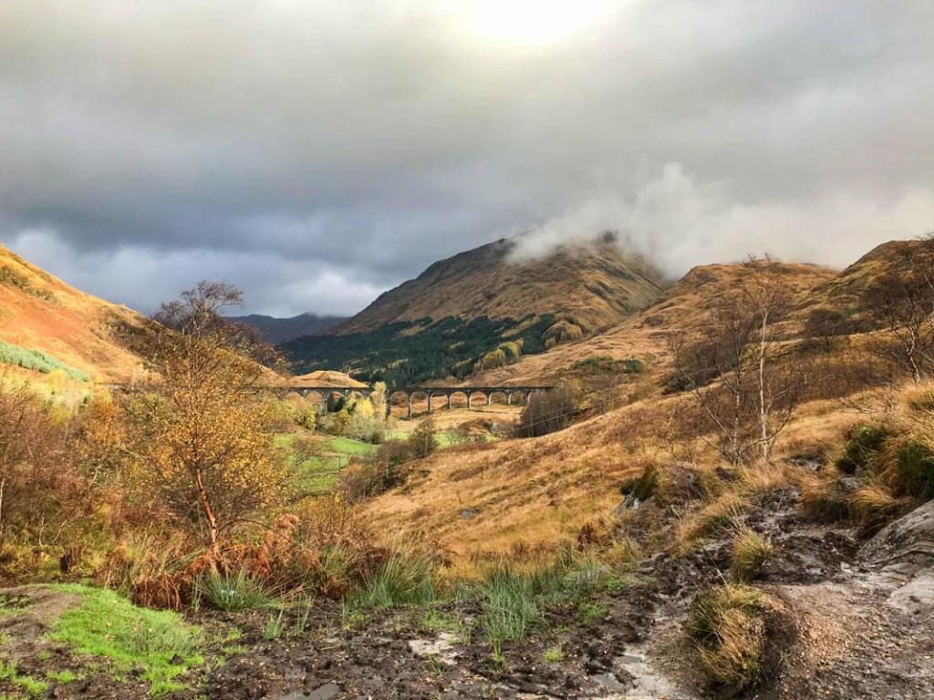 A Scotland Road Trip to Glenfinnan Viaduct in autumn is stunning