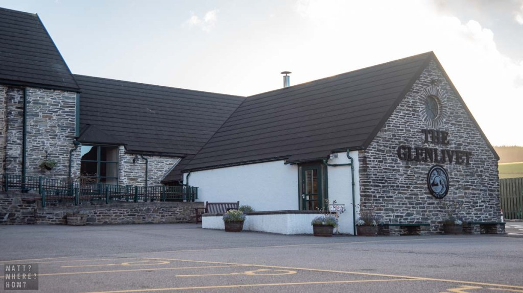 The Glenlivet Distillery is a mix of earlier buildings and modern stone and glass style.