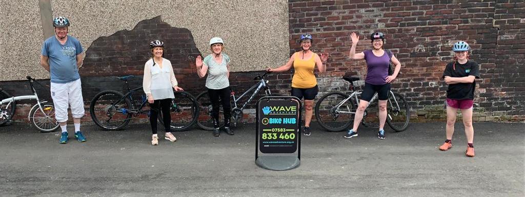 Adult beginners bikers enjoy ride from bike hub