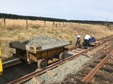 Fines from the type B trolley are used to pack and level the sleepers, with ballast then being dropped from the HD trailer