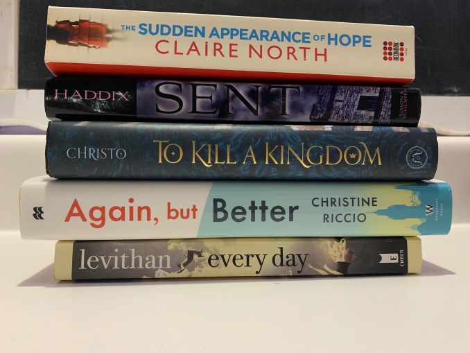 "A stack of 5 books whose titles read, from top to bottom, ""The Sudden Appearance of Hope. Sent. To Kill a Kingdom. Again, but Better. Every Day."""