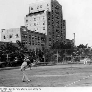 Carl Fisher plays tennis at Flamingo Hotel, 1920s.