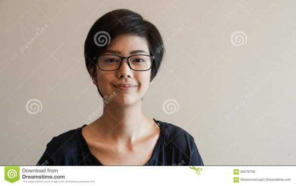 Asian Woman With Short Hair And Glasses On Color Background Stock throughout Asian Hairstyle With Glasses