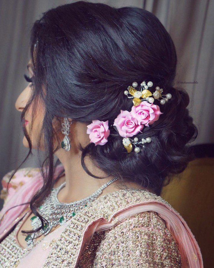 Slay The Hair On Your Engagement Pink Rose Lower Bun Loose Strands intended for Bun Hairstyle For Indian Wedding Function