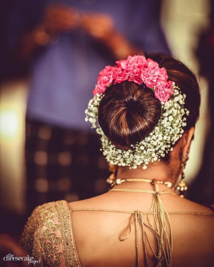 Top Trend - Floral Hairstyles For Brides This Wedding Season! inside Bun Hairstyle For Indian Wedding With Flower