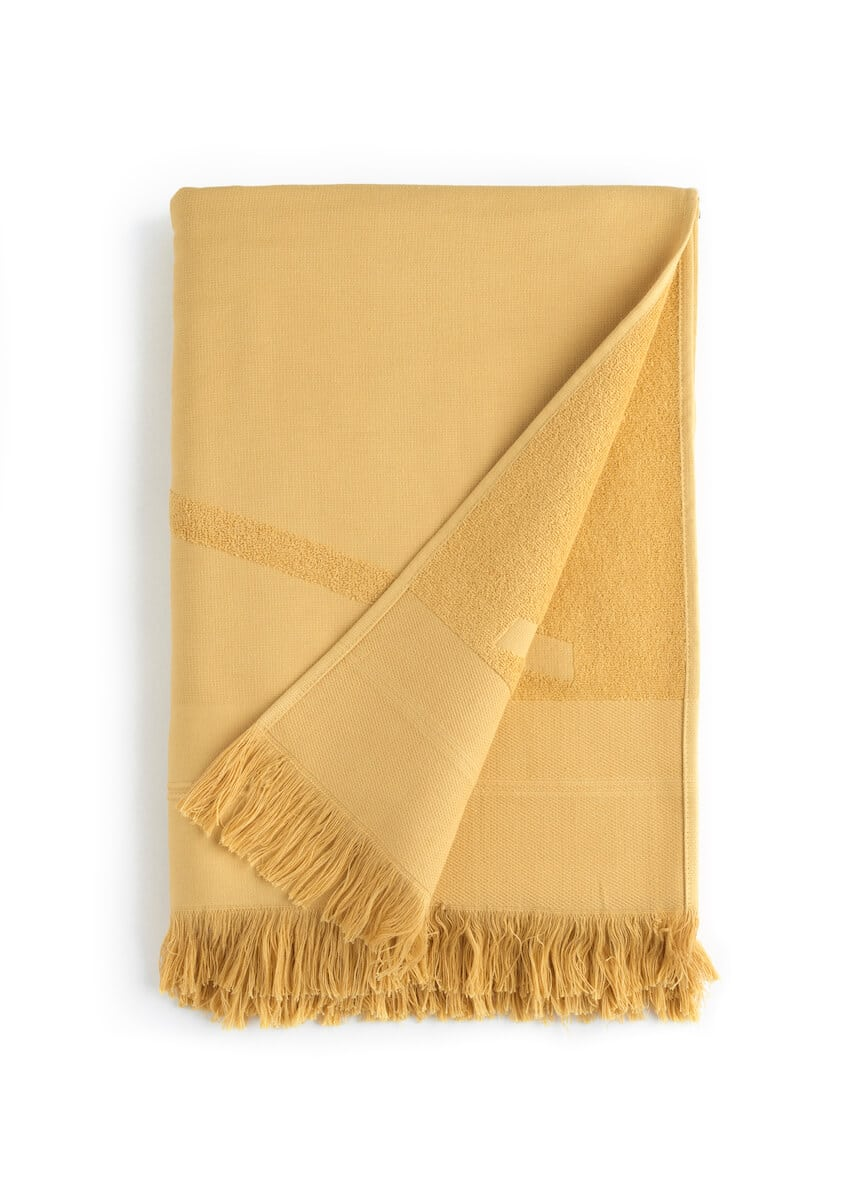 Folded yellow WAY beach towel with woven front and terry back and fringes