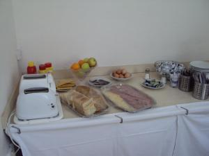 Breakfast at the hostel.  bread, jam and butter, meat, cheese, fruit, and hard boiled eggs