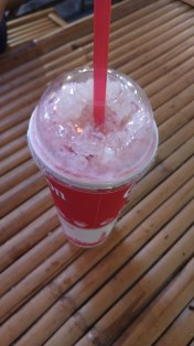 pink milk or nom yen นมเย็น, a very sweet iced pink drink with condensed milk