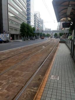 tram platform and old tram tracks next to modern pavement