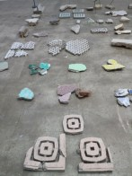 "Close up of Tanya Goel's ""Frescos"": debris fragments of stone, cement, plaster and tiles collected from demolition sites across Delhi"