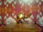 """Close up of Pio Abad's """"Oh! Oh! Oh! (A Universal History of Iniquity) of a plastic perfume bottle in the shape of a camel"""