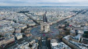 View from above of the arc de triomphe in Paris where you can clearly see all the roads leading to the round about and how it slices into the city as the city of Paris spreads out.
