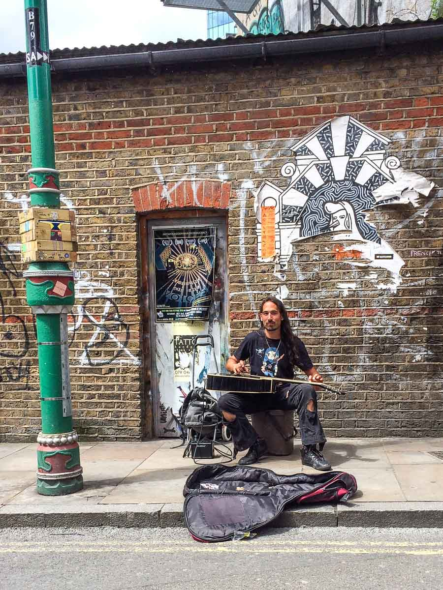 Busker on London Street Art Walking Tour