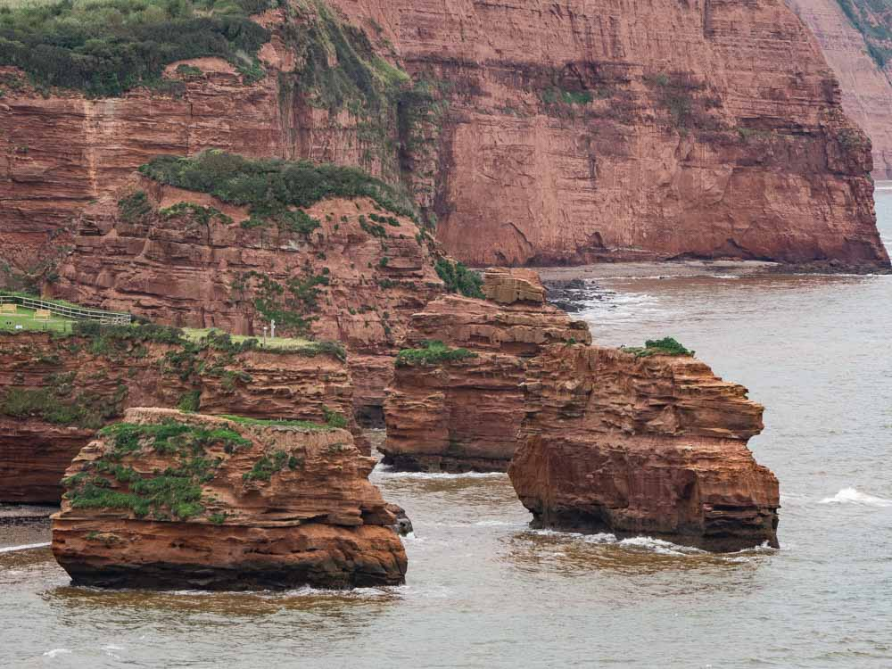 England Exmouth Jurassic Coast red stacks