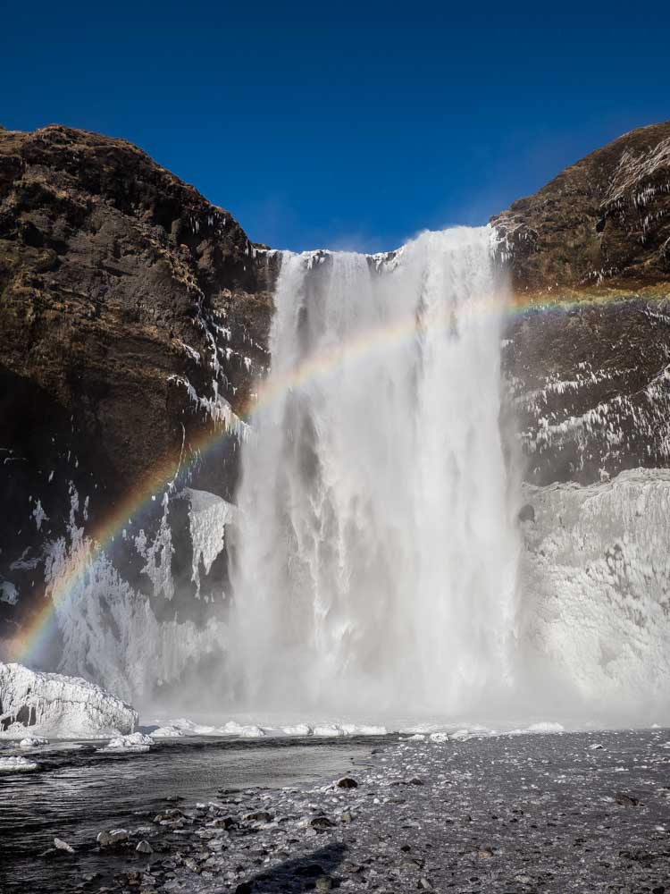 Iceland waterfall and rainbow at Skogafoss