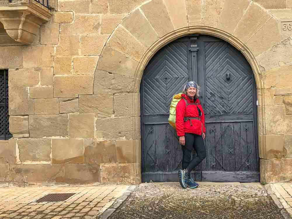 Camino de Santiago portrait. Red jacket and backpack
