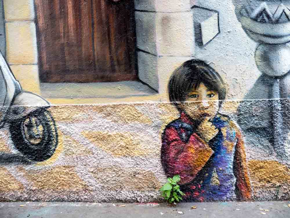 Paris street art mural of a small boy