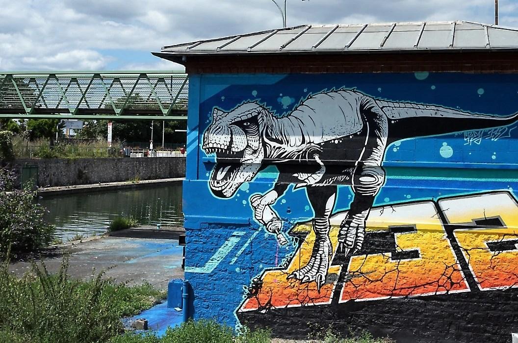 Saint Denis Canal in Paris: dinosaur mural
