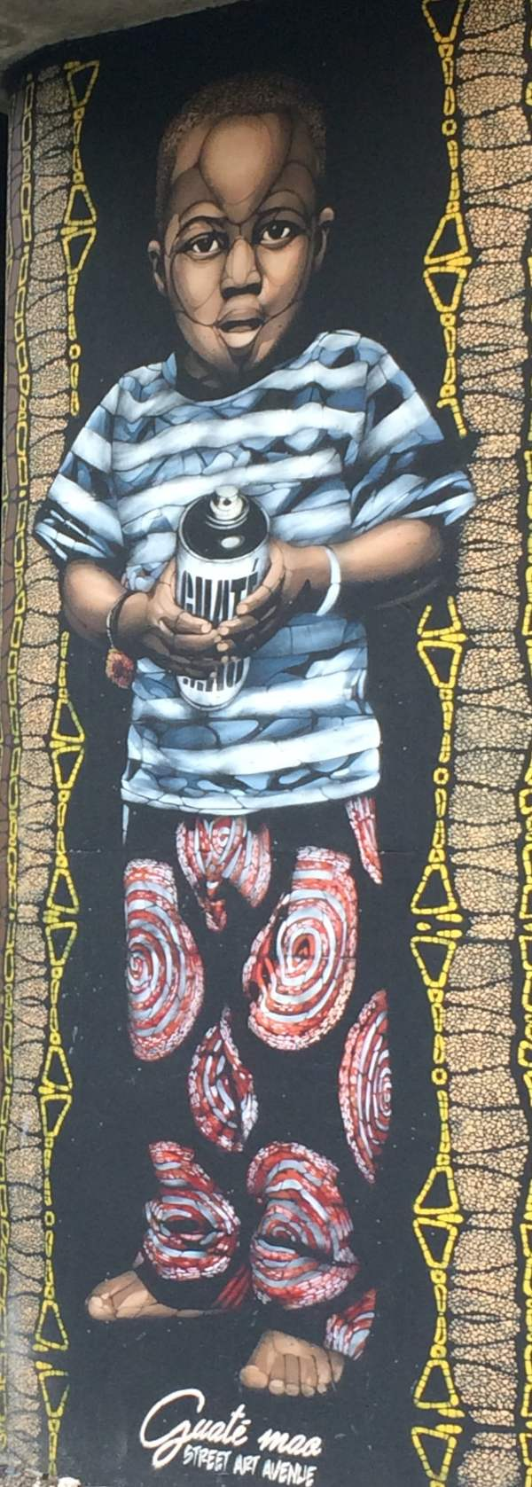 Saint Denis canal street art in Paris: Guate Mao portrait of a boy