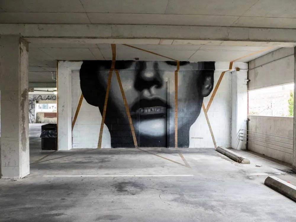 Brian Wooden mural Elliston parking garage- woman with gold stripes