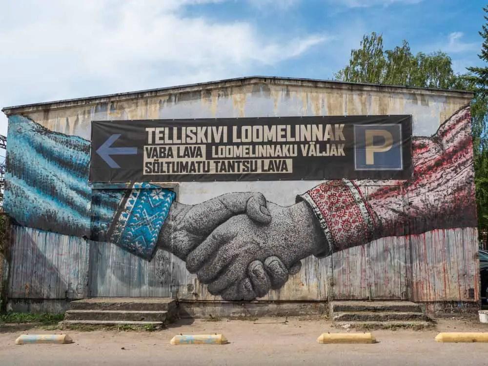 Tallinn mural: Russian Estonian handshake in red and blue