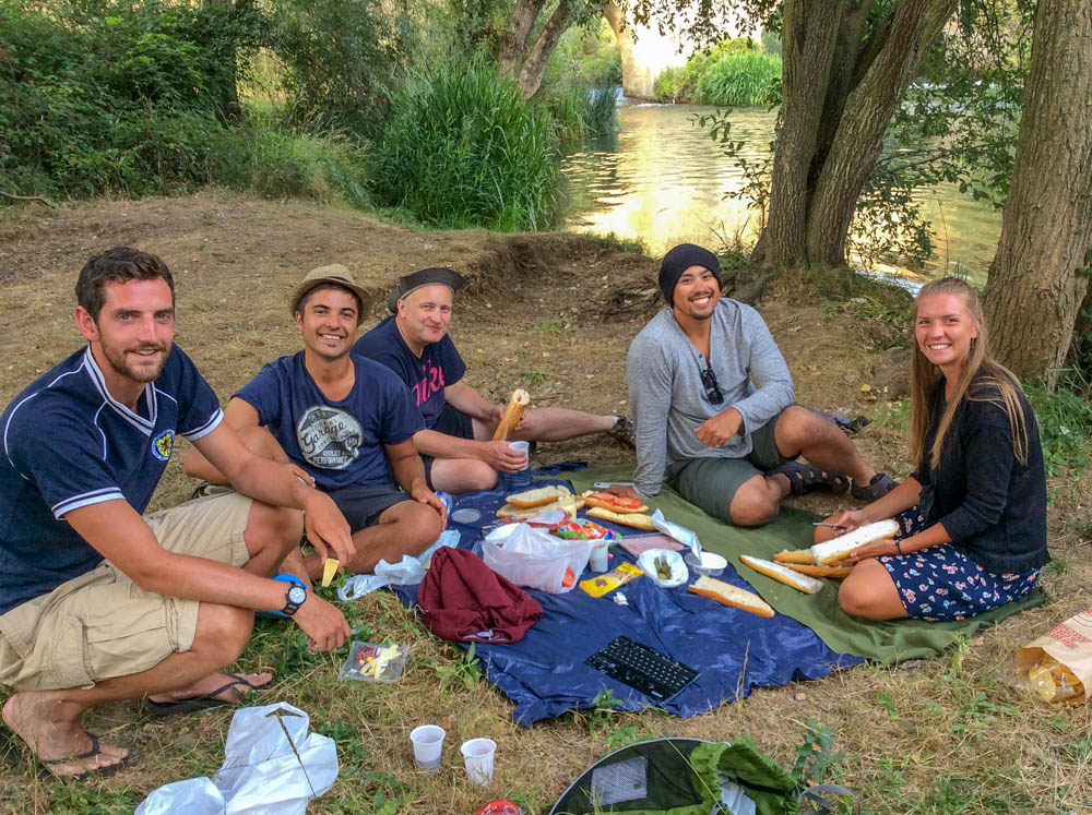 Camino de Santiago cost tips- picnic with pilgrims