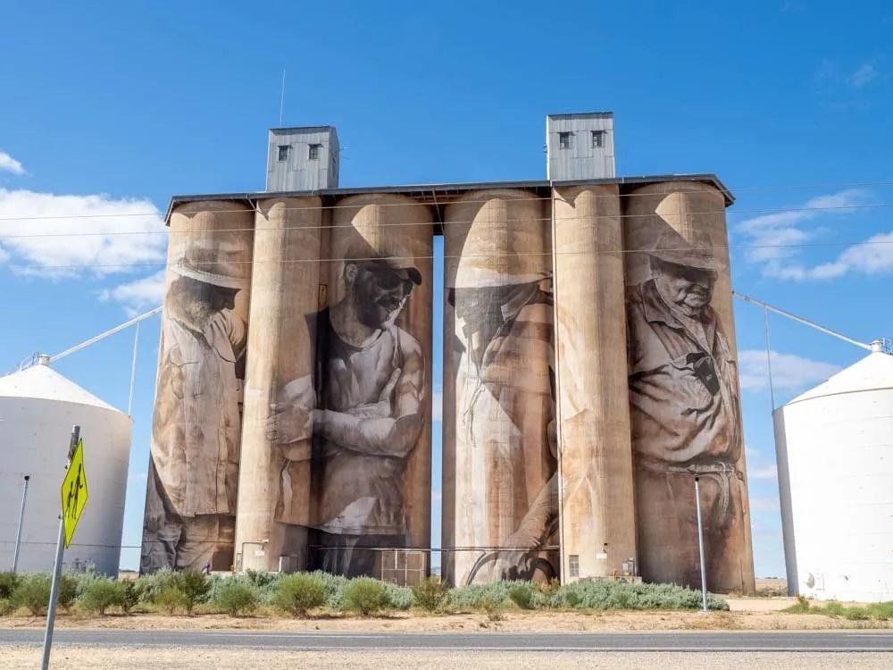 Brim silos by Guido Van Helten. Four grain silos with farmer murals