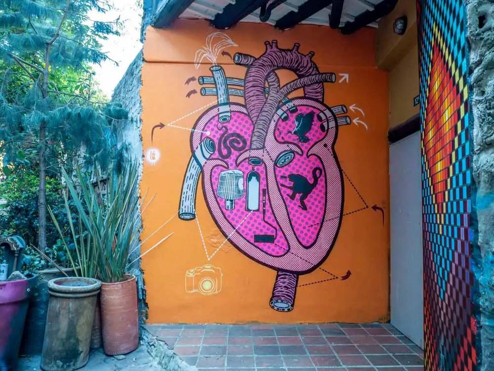 Mural at Bogota Casa Graffiti- pink heart on orange background