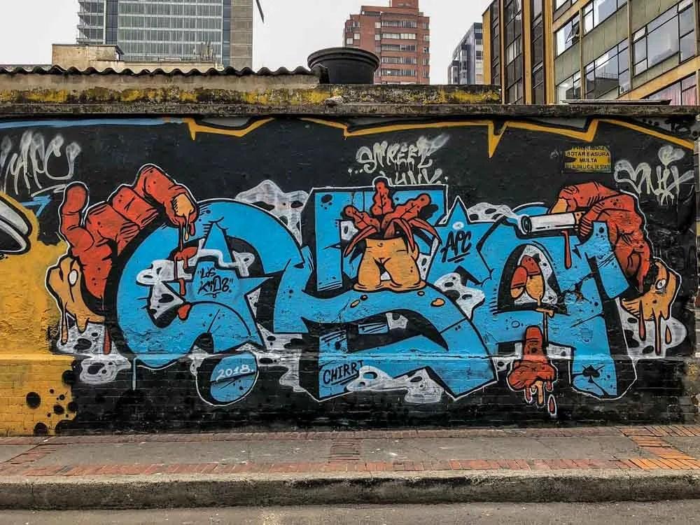 APC Crew Bogota Graffiti. Blue lettering on black background