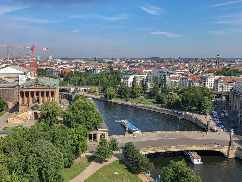 Berlin city view from Berliner Dom - a bridge and river with rooftops