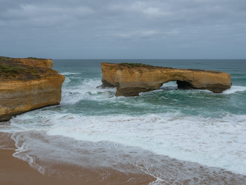 Australia's London Bridge on the Great Ocean Road. Limestone arch and rocks with ocean waves