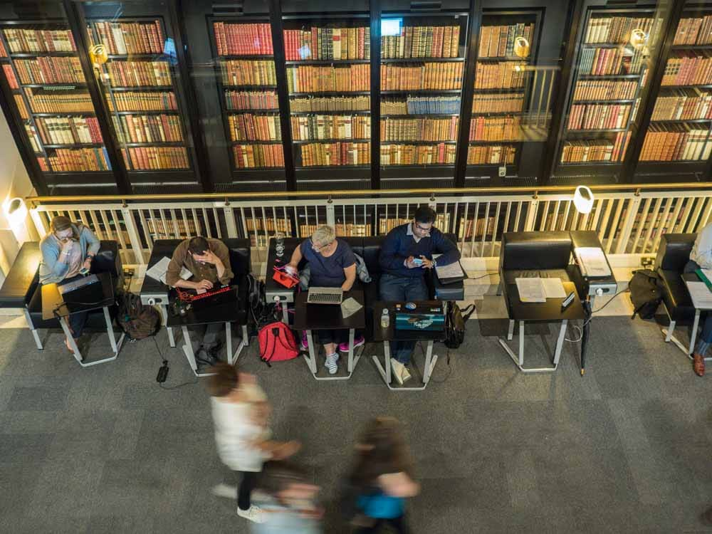 London's British Library stacks. People reading and walking by
