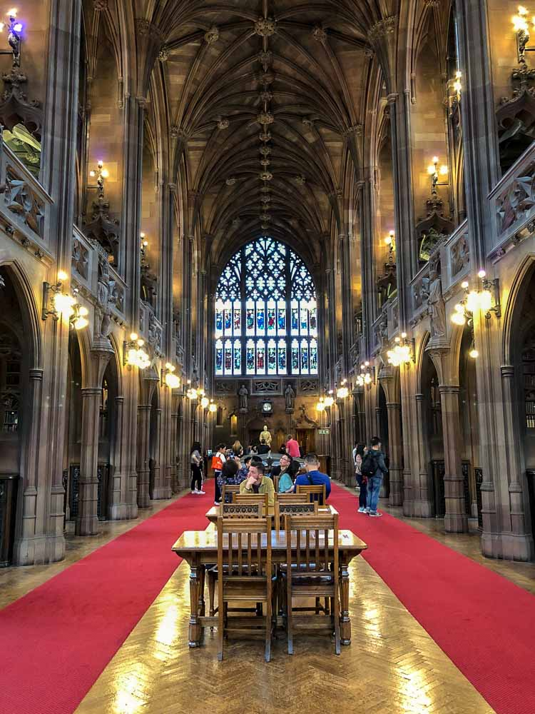 Manchester John Rylands Library. vaulted room desk chairs and red carpet