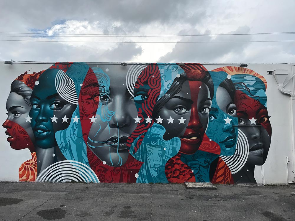 Miami Wynwood Walls mural by Tristan Eaton. Blue and red faces