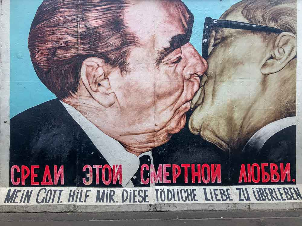 Berlin East Side Gallery Fraternal Kiss Dmitri Vrubel. two men kissing