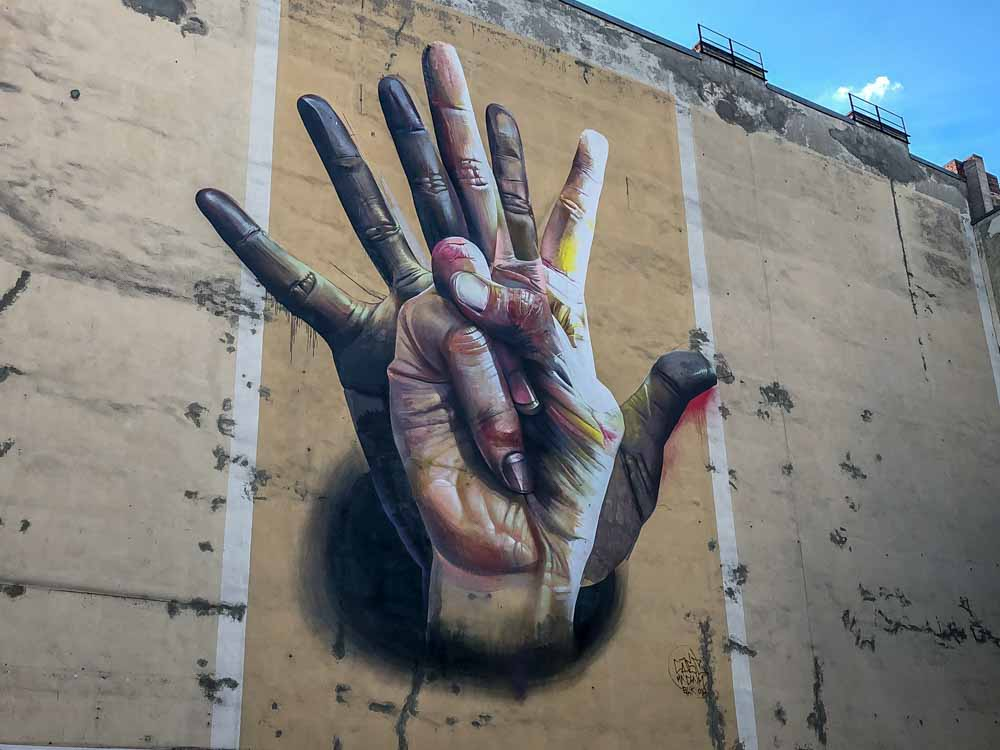 Berlin mural by Case. Two hands