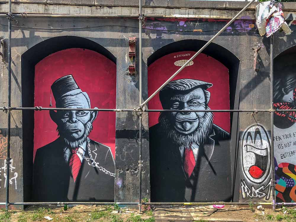 Berlin mural Urban Spree Shinanov with Donald Trump